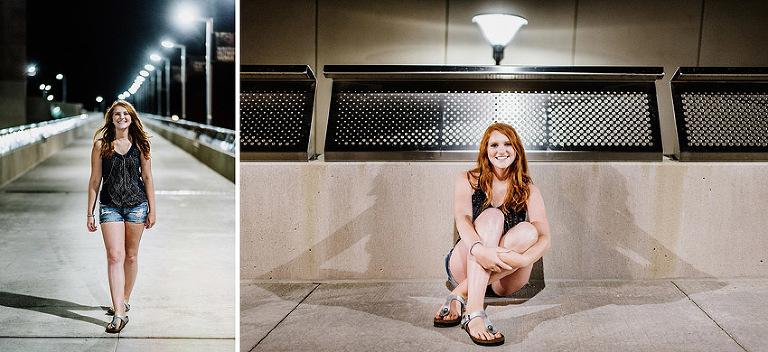 redhead senior girl walking and sitting downtown on a bridge at night