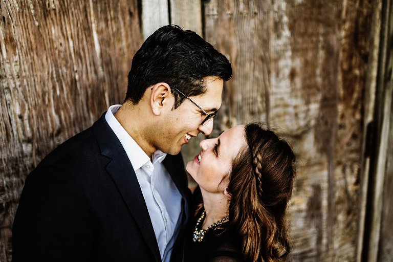 two people looking into each others eyes and smiling