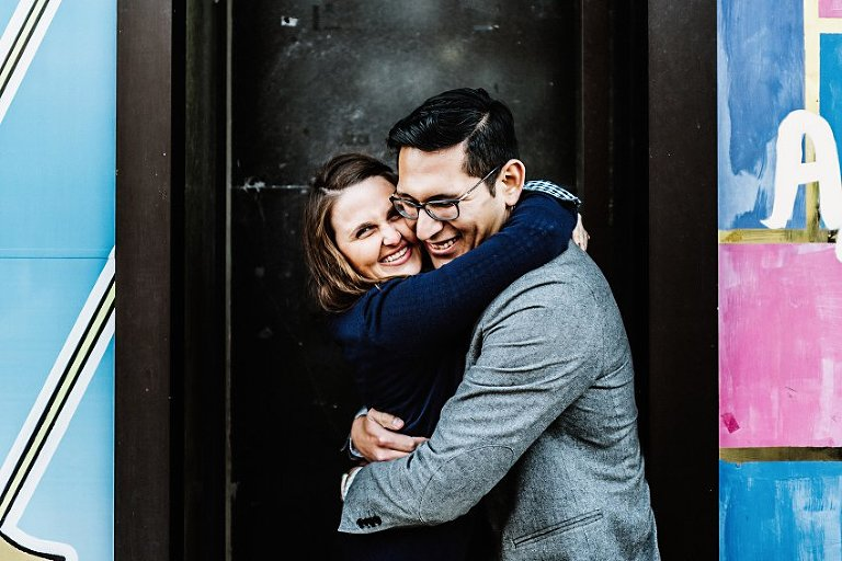 a couple hugging and smiling