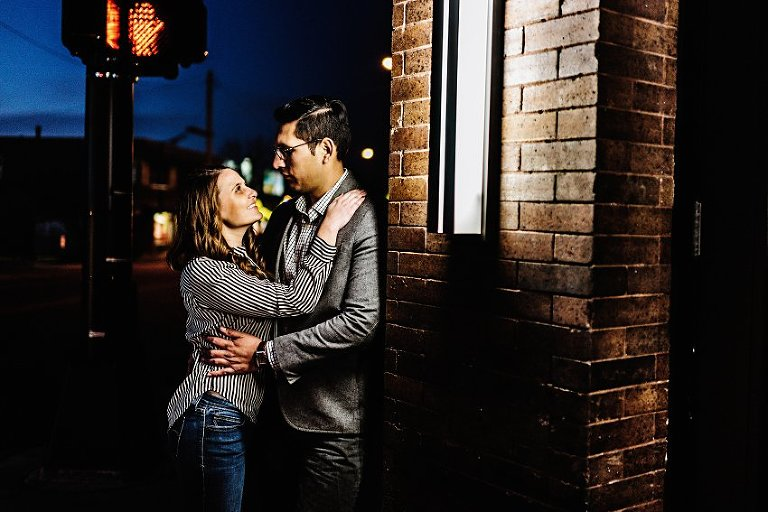 holding each other under the street lights