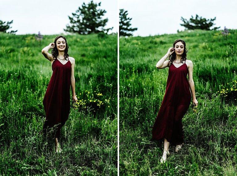 a girl in a red dress walking in a field