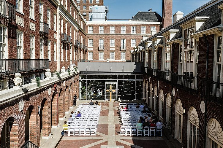 the wedding ceremony courtyard with guests arriving