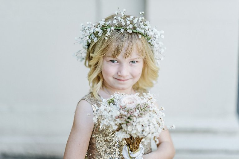 flower girl posing and smiling at the camera