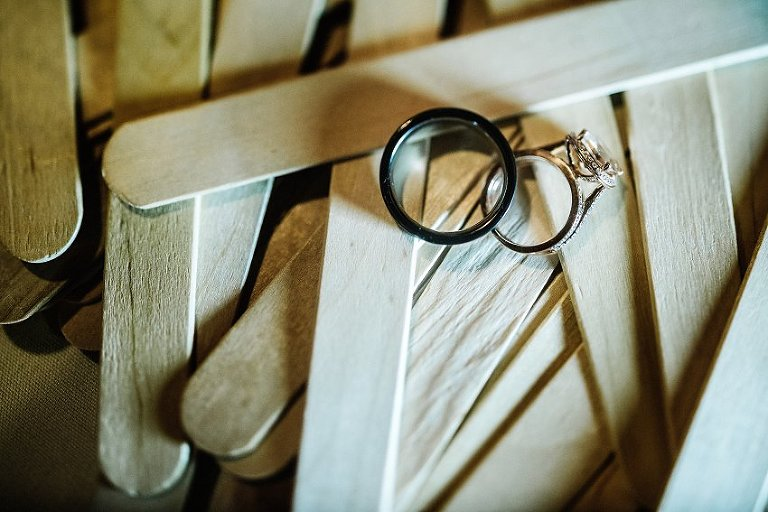 the wedding rings sitting on Popsicle sticks