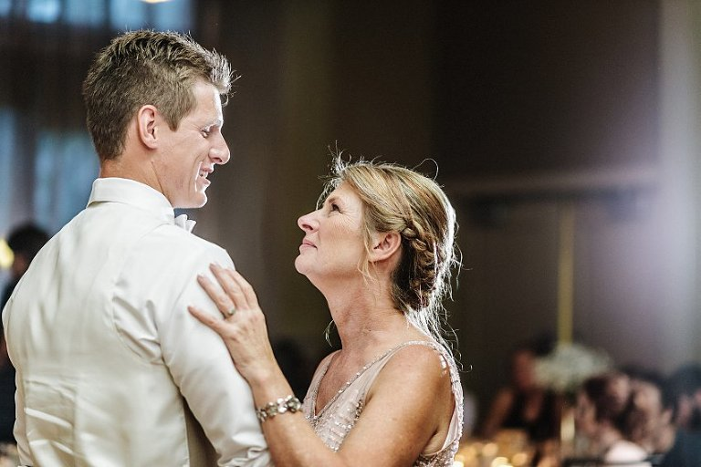 a groom dances with his mother