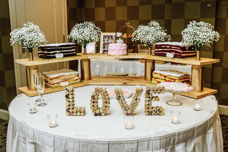 wedding cakes with the word love spelled out with wine corks