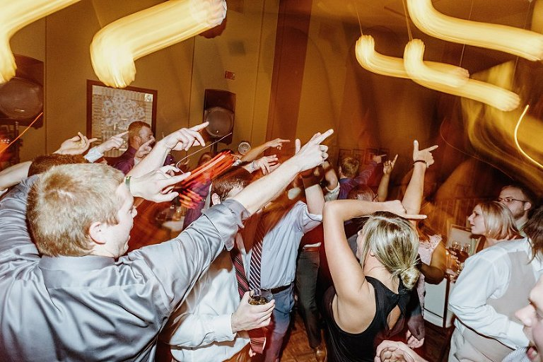 wedding reception photo of people gesturing to music