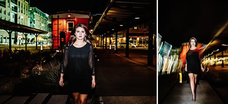 girl in a black dress walking towards the camera very serious at night