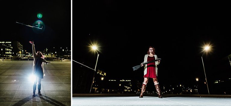 girl in a red dress at night twirling a rifle