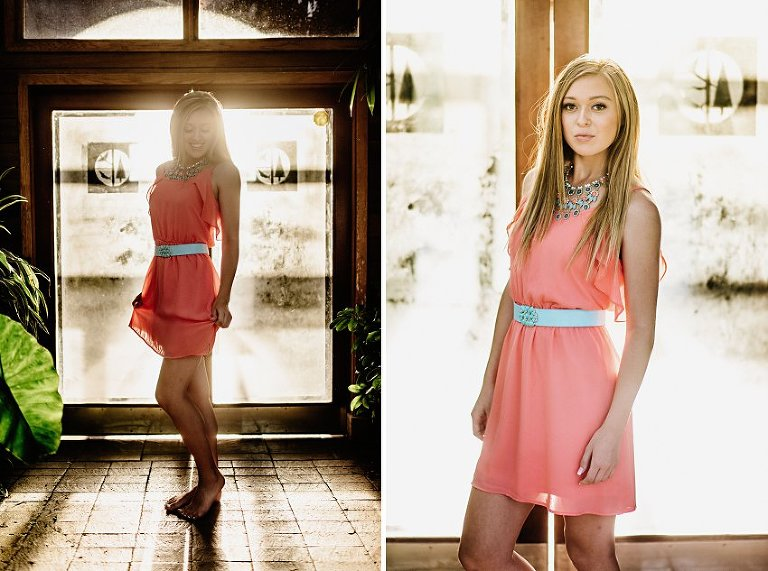 girl in a pink dress standing in a glass building with light shining in the doors behind her