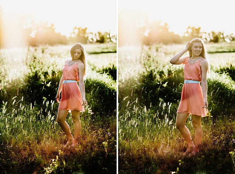 girl in a pink dress in a hazy sunset standing in tall grass