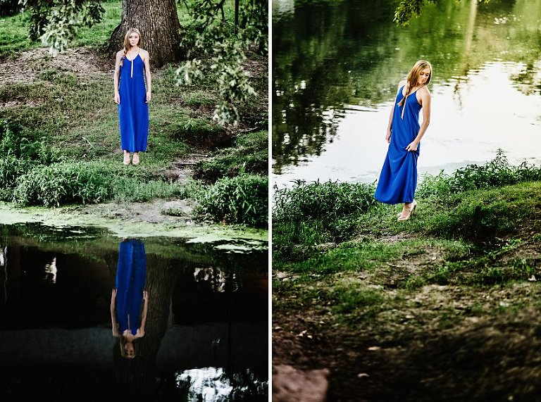 girl in a long blue dress standing by the edge of water